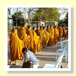 Buddhist monks collecting alms