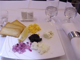 Thai Airways first class table with the caviar served onto the plate