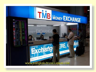 Currency exchange booth at Suvarnabhumi Airport arrivals