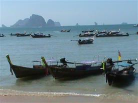 Boats on Ao Nang beach to take you on tours of the islands