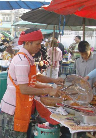 Bangkok fried chicken cooked in a street market stall
