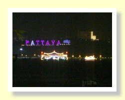 Pattaya sign at night looking across Pattaya Bay