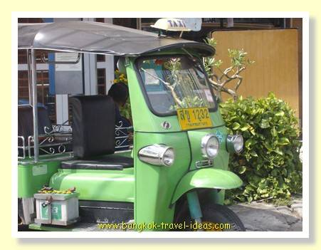 Tuk tuk delivering shoppers to the Emporium shopping mall