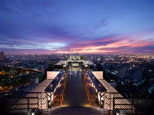 Watch the sunset over Bangkok at the Banyan Tree Hotel