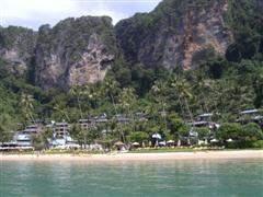 Centara Grand Resort and Villas viewed from the sea with the limestone cliffs in the background
