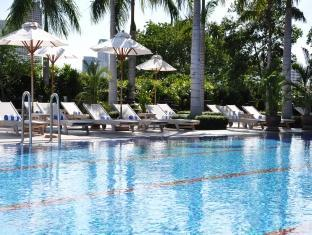 Swim in the pool at the Chatrium Riverside Bangkok
