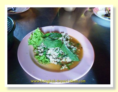 Larb Moo on a plate with sticky rice