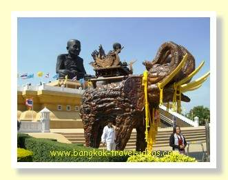 Wat Huay Mongkol with Luang Phor Thuad in the background with the lucky elephant in the foreground.