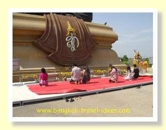 The base of the Luang Phor Thuad statue where you can make merit and request for good luck.