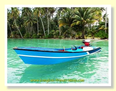 Fishermans boat moored at the jetty at Dusita Resort