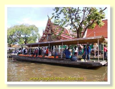 Tour boat outside the temple at Kwan Riam floating market