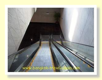 Escalator down to the hotel walkway