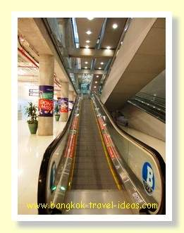 Escalator up to Gate 8 and bus to Pattaya