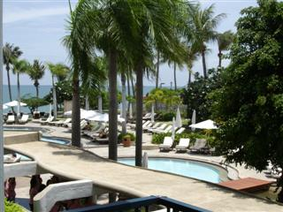 Pattaya tourists love the pool and garden at the Dusit Thani resort