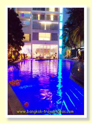 Night view of swimming pool at the DusitD2 Pattaya Hotel