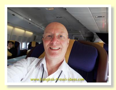 Sitting in Seat 1A in First Class on Thai Airways bound for Sydney