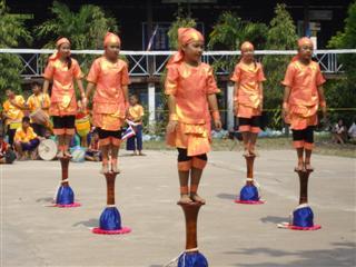 Thai school dancers stood on drums