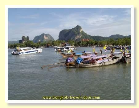 Speed boats at the Nopparattara pier near Ao Nang and heading for Phi Phi