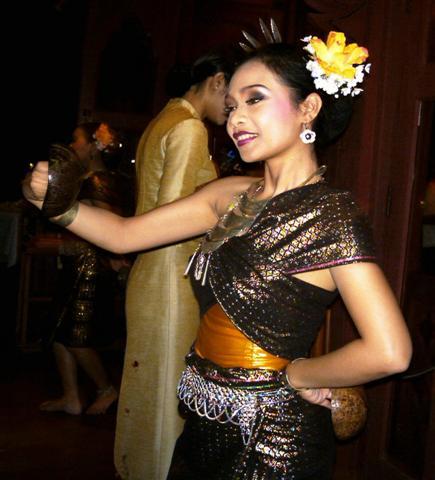 Thai girl dancing a traditional Thai dance