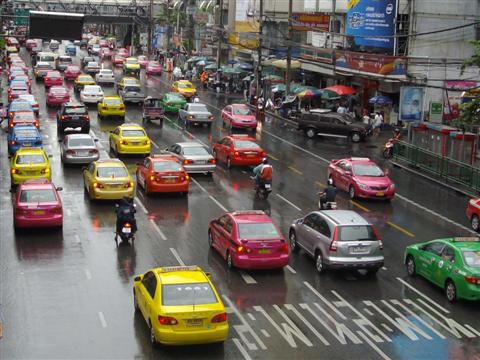 Bangkok traffic chaos with Bangkok taxis competing for customers
