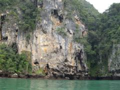 Large limestone cliffs tower above the Centara Grand Resort at Ao Nang