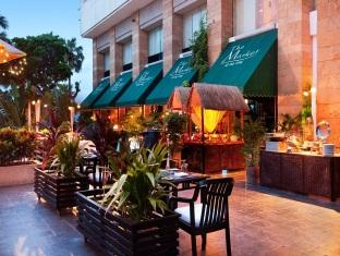Dine in elegance in the outdoor dining area at the Hua Hin Hilton Hotel