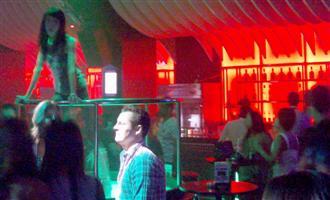 Club Insomnia go go dancer shaking her booty