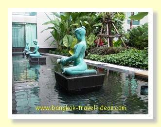 Small statues around the swimming pool
