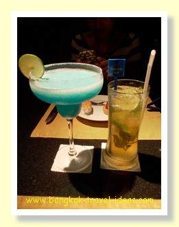 A blue margarita and one night in Bangkok cocktails