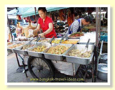 Thai food stall at the local market where food is prepared freshly each day