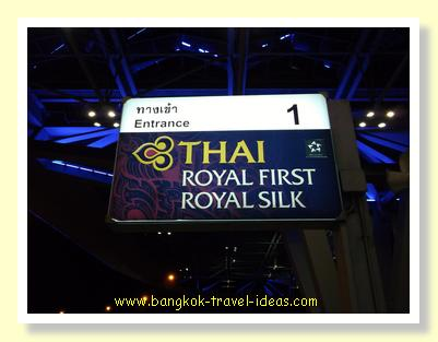 Get out the taxi at gate 1 for Thai Airways First Class check-in