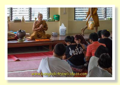 Monk's blessing at Wat Asokaram