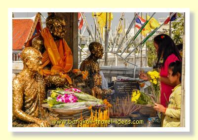 Saying a prayer at Wat Hua Lamphong
