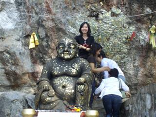 Can you see the Buddha image in the rock face?